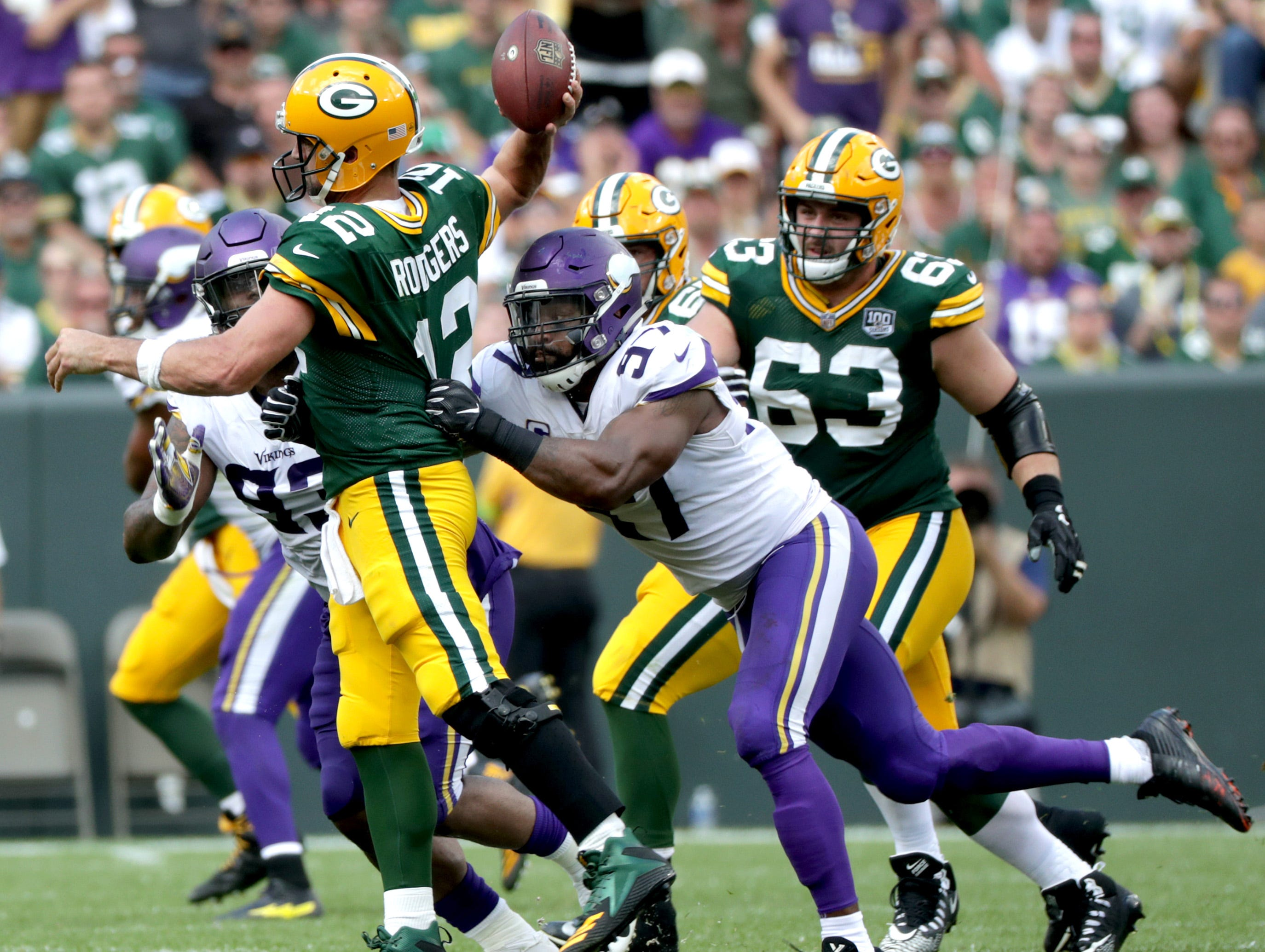 Green Bay Packers quarterback Aaron Rodgers is pressured in the fourth qaurter by Minnesota Vikings defensive end Everson Griffen during their football game on Sunday, September 16, 2018, at Lambeau Field in Green Bay, Wis. The game ended in a 29 to 29 tie.Wm. Glasheen/USA TODAY NETWORK-Wisconsin.