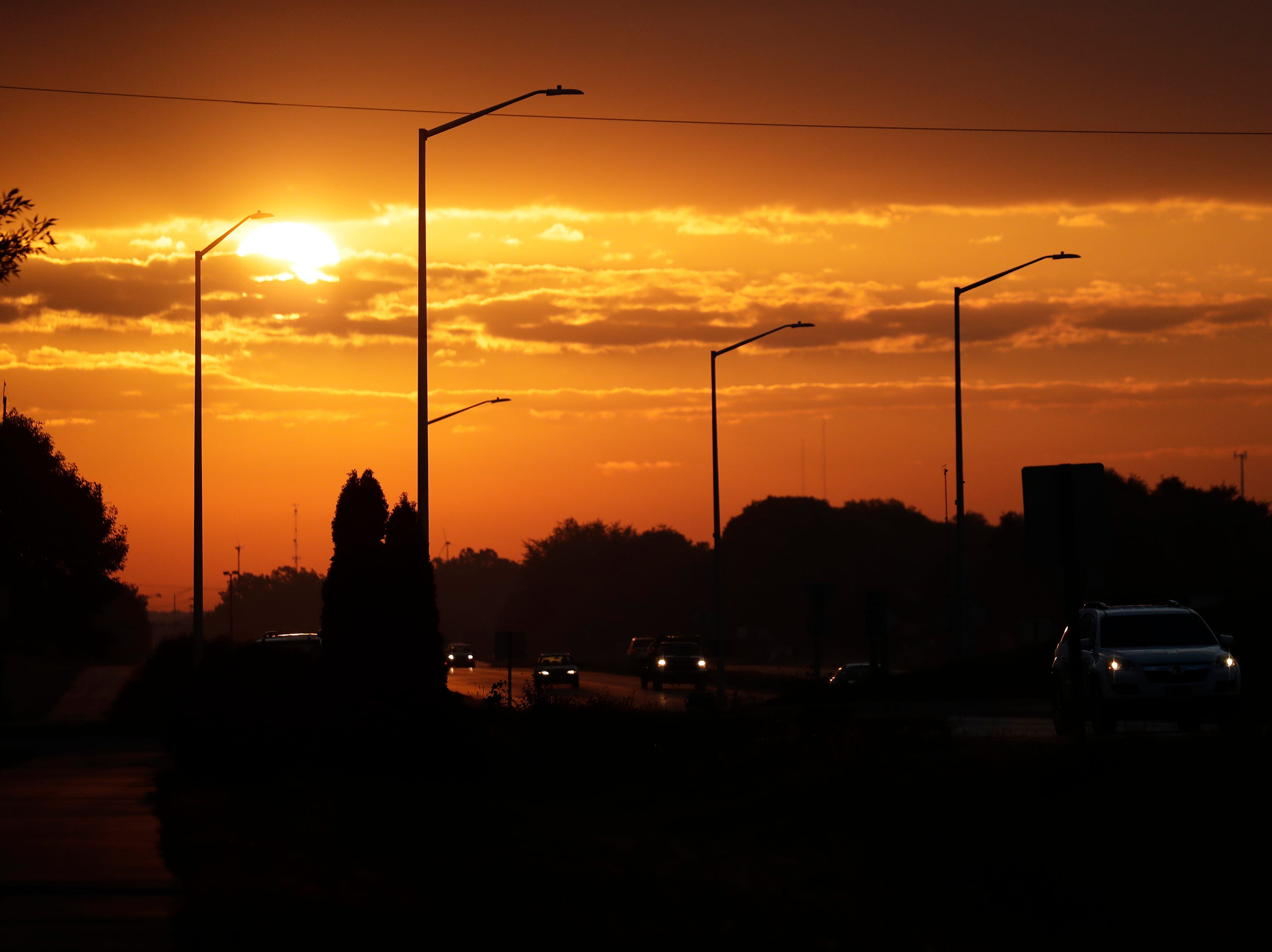 Commuters travel along County Rd CE as the sun rises Friday, Sept. 14, 2018, in Combined Locks, Wis. Dan Powers/USA TODAY NETWORK-Wisconsin
