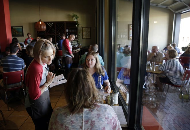 Sarah Knapstein takes an order from customers Sunday at SAP Brunch, Brown Bag & Bakery in Grand Chute. SAP is among more than 20 restaurants taking part in Fox Valley Restaurant Tour Week.