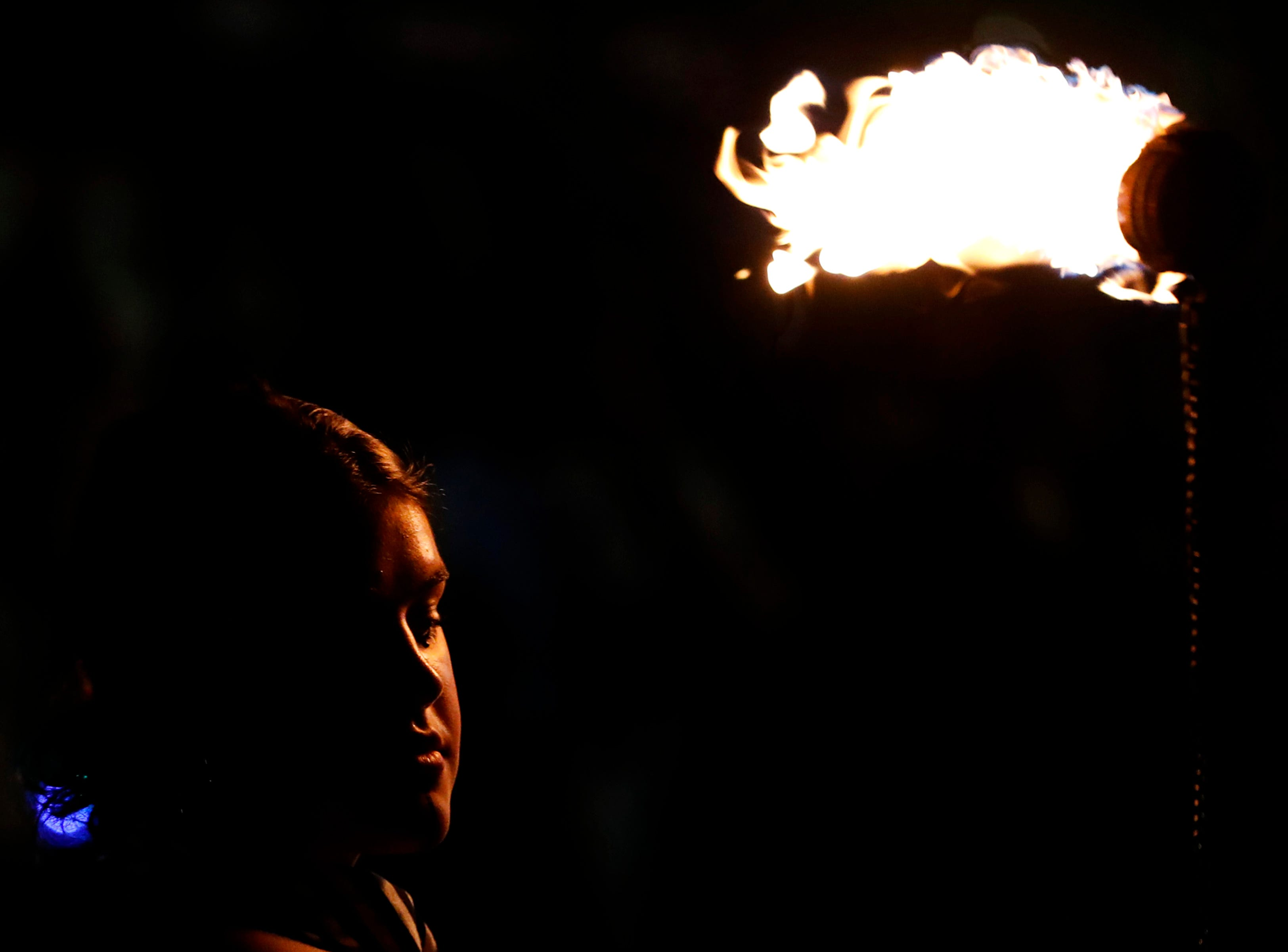 Maggie Pearce, with Fox Valley Fire and Flow Collective, is illuminated while dancing with fire during Bazaar After Dark Wednesday, Sept. 12, 2018, in Menasha, Wis.Danny Damiani/USA TODAY NETWORK-Wisconsin