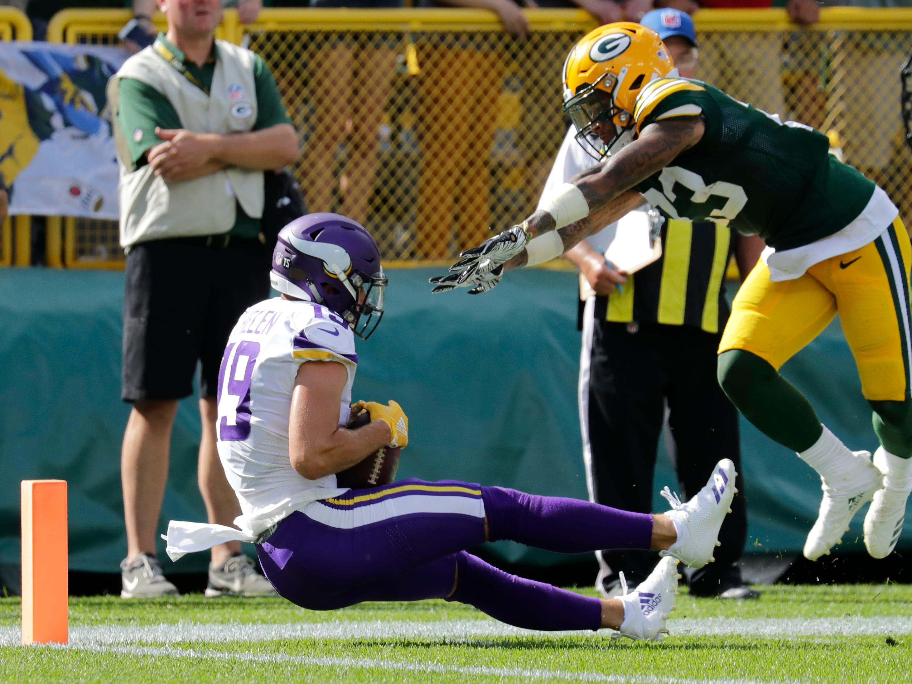 Minnesota Vikings wide receiver Adam Thielen (19) scores a touchdown against Green Bay Packers cornerback Jaire Alexander (23) late in the fourth quarter during their football game Sunday, Sept. 16, 2018, at Lambeau Field in Green Bay, Wis. The Vikings scored a two point conversion to tie the game.Dan Powers/USA TODAY NETWORK-Wisconsin