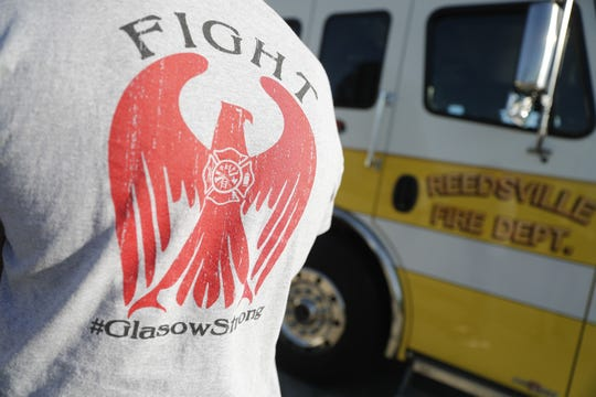 "The back of Jacob Glasow's shirt reads ""Fight #GlasowStrong."" Jacob was diagnosed with amyotrophic lateral sclerosis, or ALS, in July. The Reedsville and Brillion fire departments are raising money to support his family."