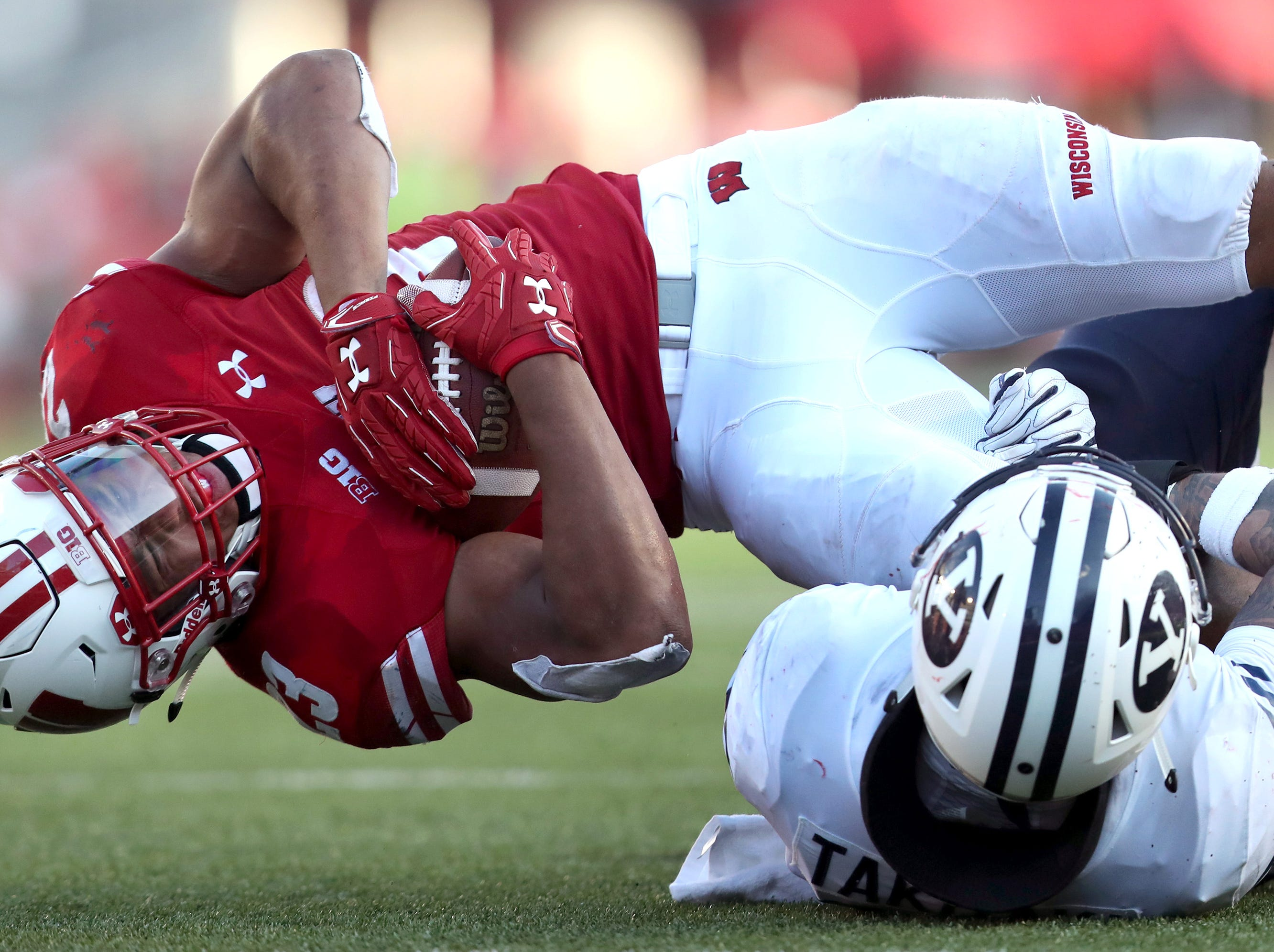Wisconsin Badgers running back Jonathan Taylor (23) is brought down by Brigham Young Cougars linebacker Sione Takitaki (16) Saturday, Sept. 15, 2018, at Camp Randall Stadium in Madison, Wis.Danny Damiani/USA TODAY NETWORK-Wisconsin