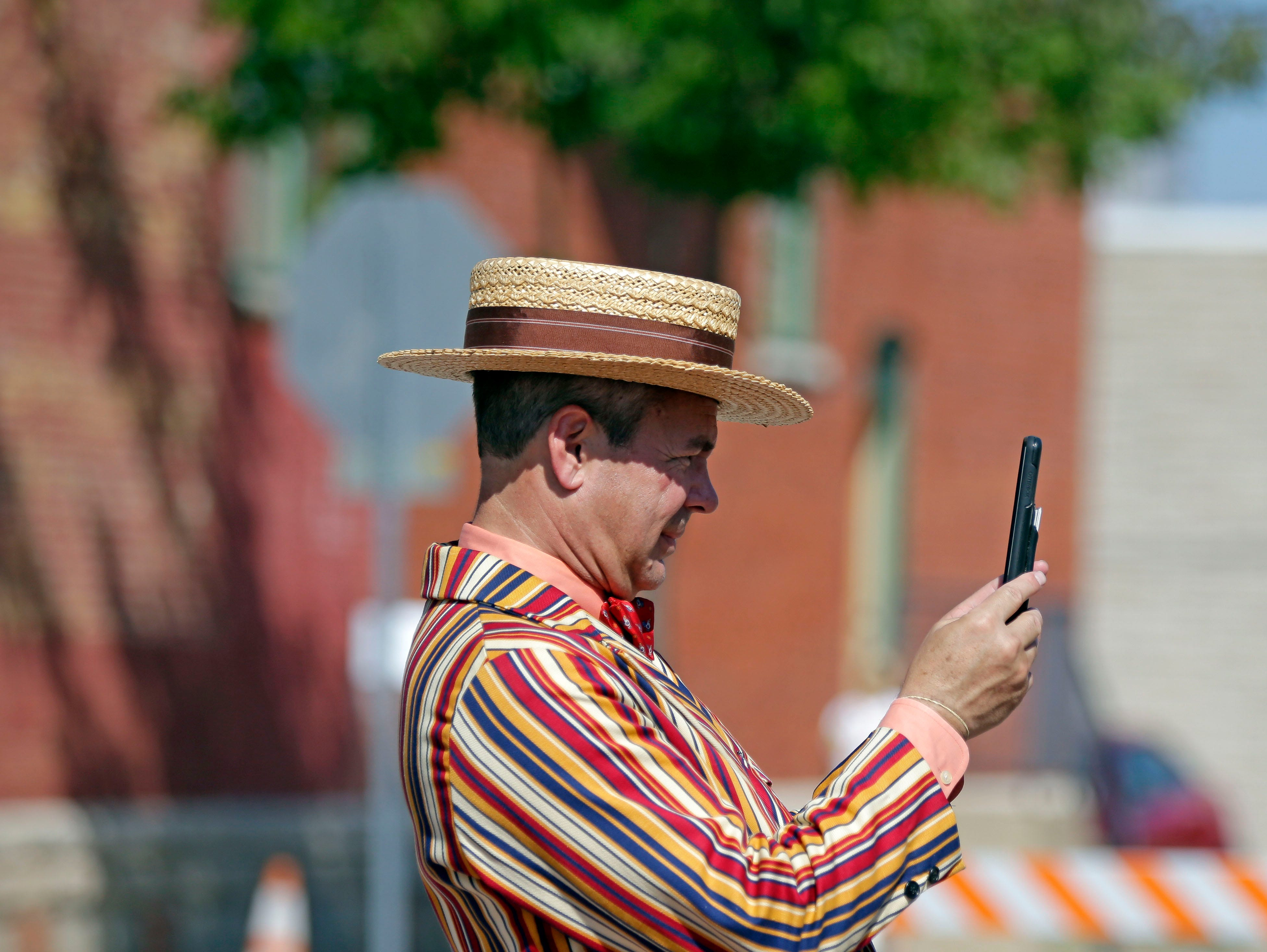 Tim Dietzen is dressed for the period as he records the parade during Horse and Buggy Days Saturday, September 15, 2018, in Weyauwega, Wis.Ron Page/USA TODAY NETWORK-Wisconsin