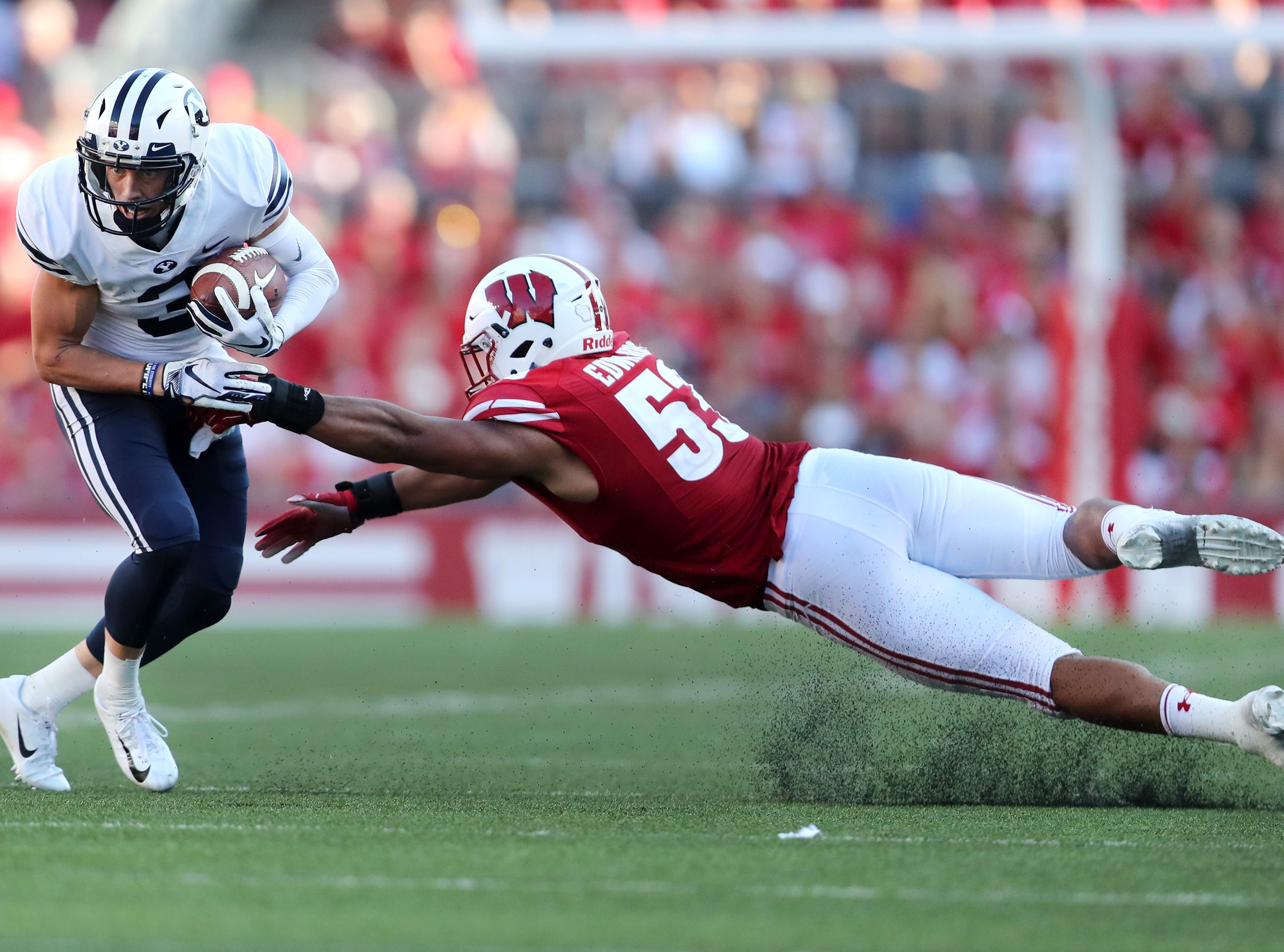 Wisconsin Badgers linebacker T.J. Edwards (53) slips as he tries to tackle Brigham Young Cougars wide receiver Dylan Collie (3) Saturday, Sept. 15, 2018, at Camp Randall Stadium in Madison, Wis.Danny Damiani/USA TODAY NETWORK-Wisconsin