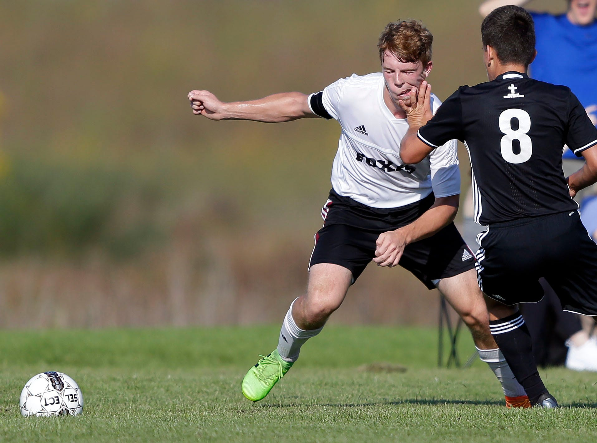 Blaine Van Asten of Fox Valley Lutheran catches a hand from Colin Podojil of Xavier in the Xavier boys soccer tournament Saturday, September 15, 2018, at the Scheels USA Sports Complex in Appleton, Wis.Ron Page/USA TODAY NETWORK-Wisconsin