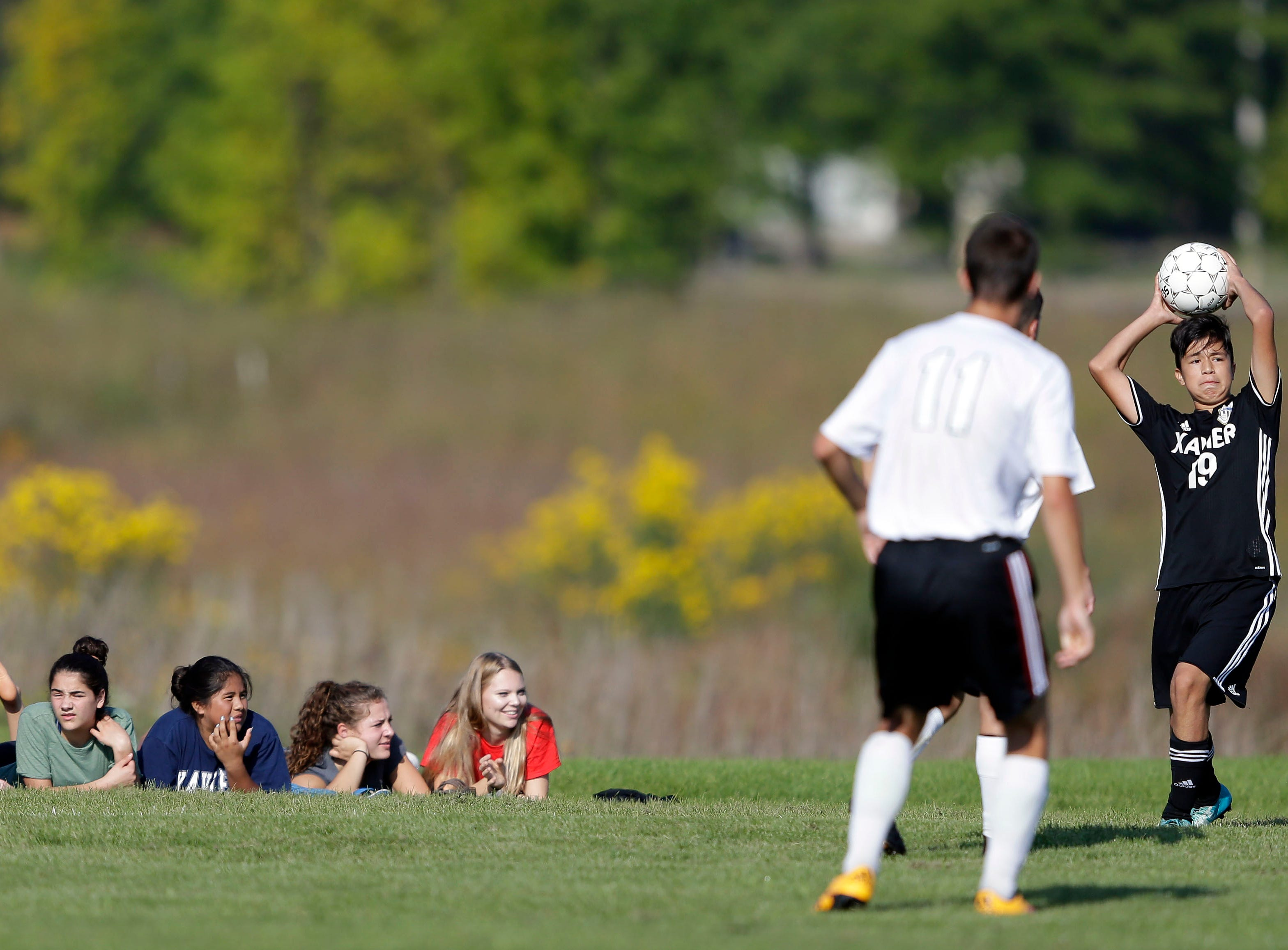 Bryan Munguia of Xavier looks for an opening against Fox Valley Lutheran as fans watch the game at the Xavier boys soccer tournament Saturday, September 15, 2018, at the Scheels USA Sports Complex in Appleton, Wis.Ron Page/USA TODAY NETWORK-Wisconsin