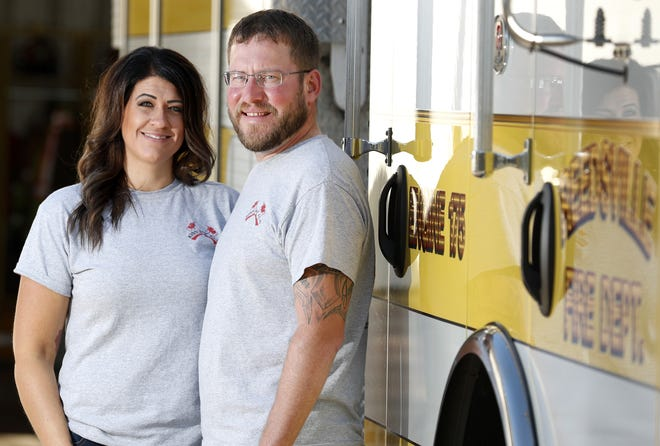 Sheena Glasow stands with her husband, Jacob Glasow, for a portrait at the Reedsville Fire Department, where Jacob is a volunteer firefighter.
