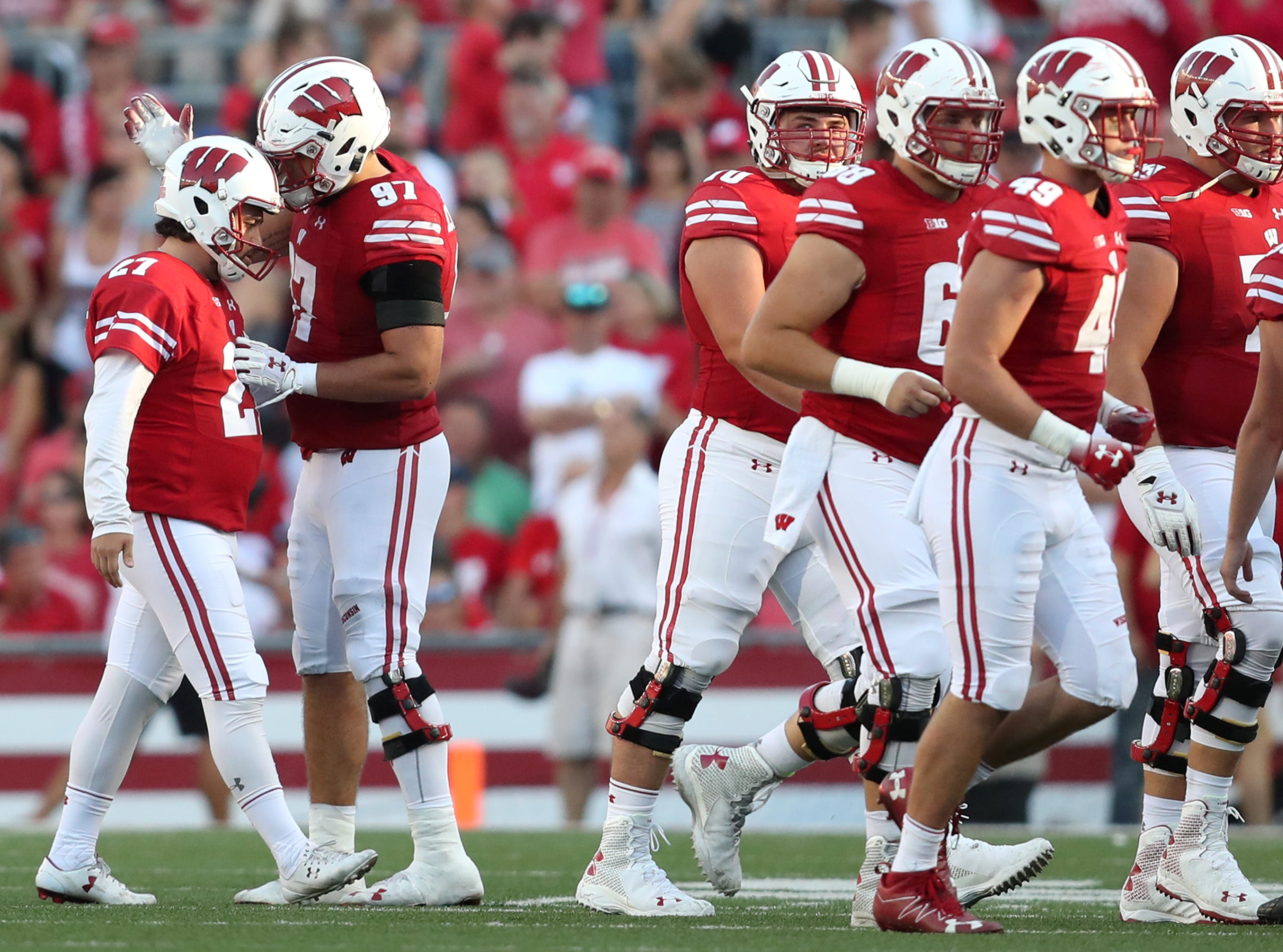 Wisconsin Badgers place kicker Rafael Gaglianone (27) is comforted by Wisconsin Badgers defensive end Isaiahh Loudermilk (97) after Gaglianone missed a 42-yard field goal attempt that would have tied their game against the Brigham Young Cougars Saturday, Sept. 15, 2018, at Camp Randall Stadium in Madison, Wis. The Wisconsin Badgers lost to the Brigham Young Cougars 24-21.Danny Damiani/USA TODAY NETWORK-Wisconsin