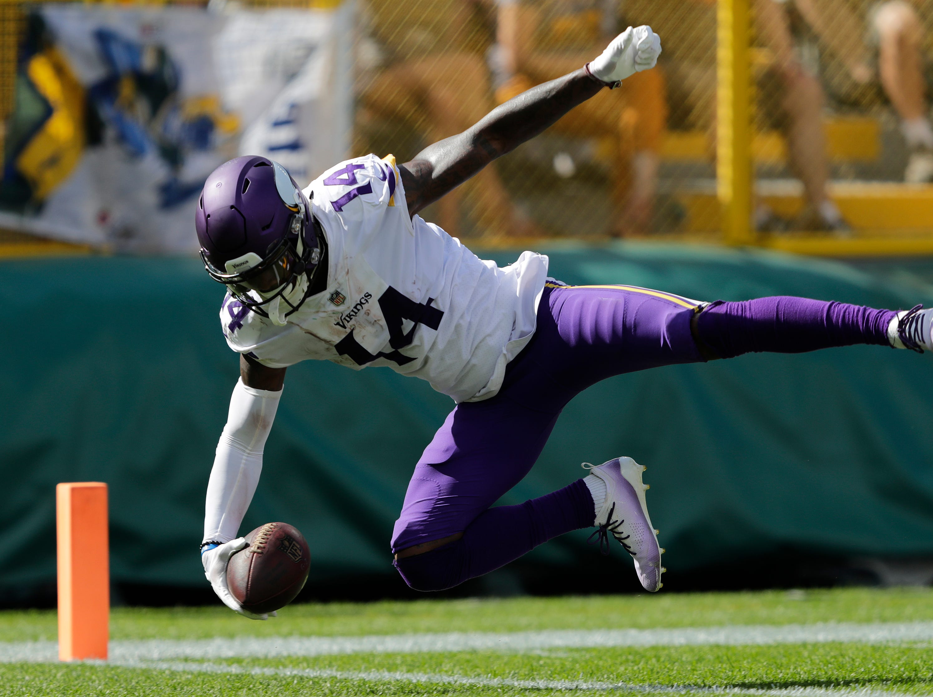 Minnesota Vikings wide receiver Stefon Diggs (14) dives into the end zone for a touchdown reception against the Green Bay Packers in the third quarter during their football game Sunday, Sept. 16, 2018, at Lambeau Field in Green Bay, Wis. Dan Powers/USA TODAY NETWORK-Wisconsin
