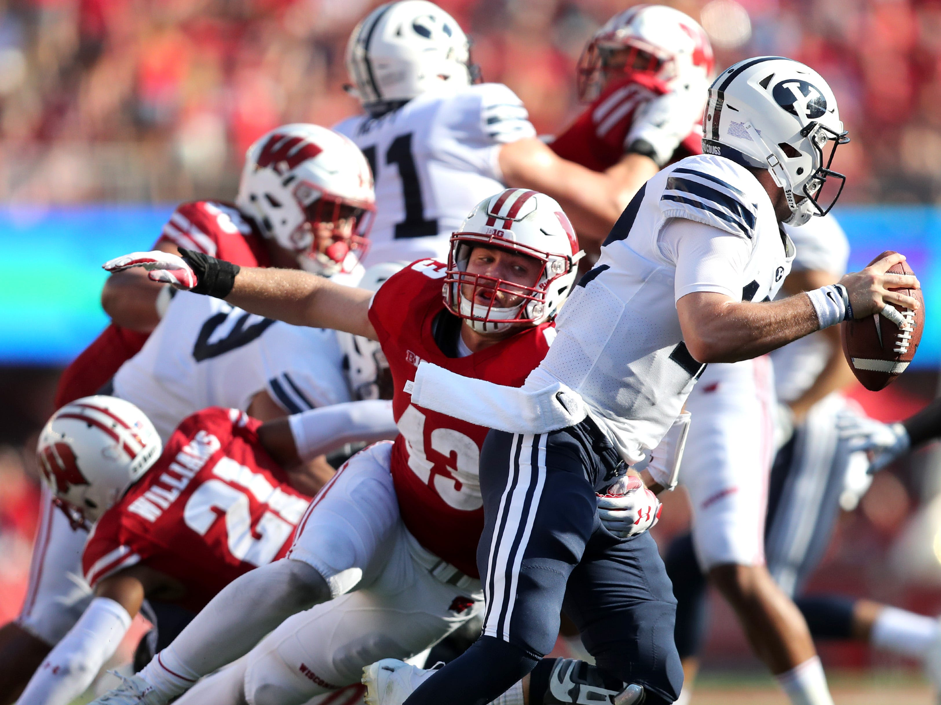 Wisconsin Badgers safety Evan Bondoc (13) tries to wrap up Brigham Young Cougars quarterback Tanner Mangum (12) Saturday, Sept. 15, 2018, at Camp Randall Stadium in Madison, Wis.Danny Damiani/USA TODAY NETWORK-Wisconsin