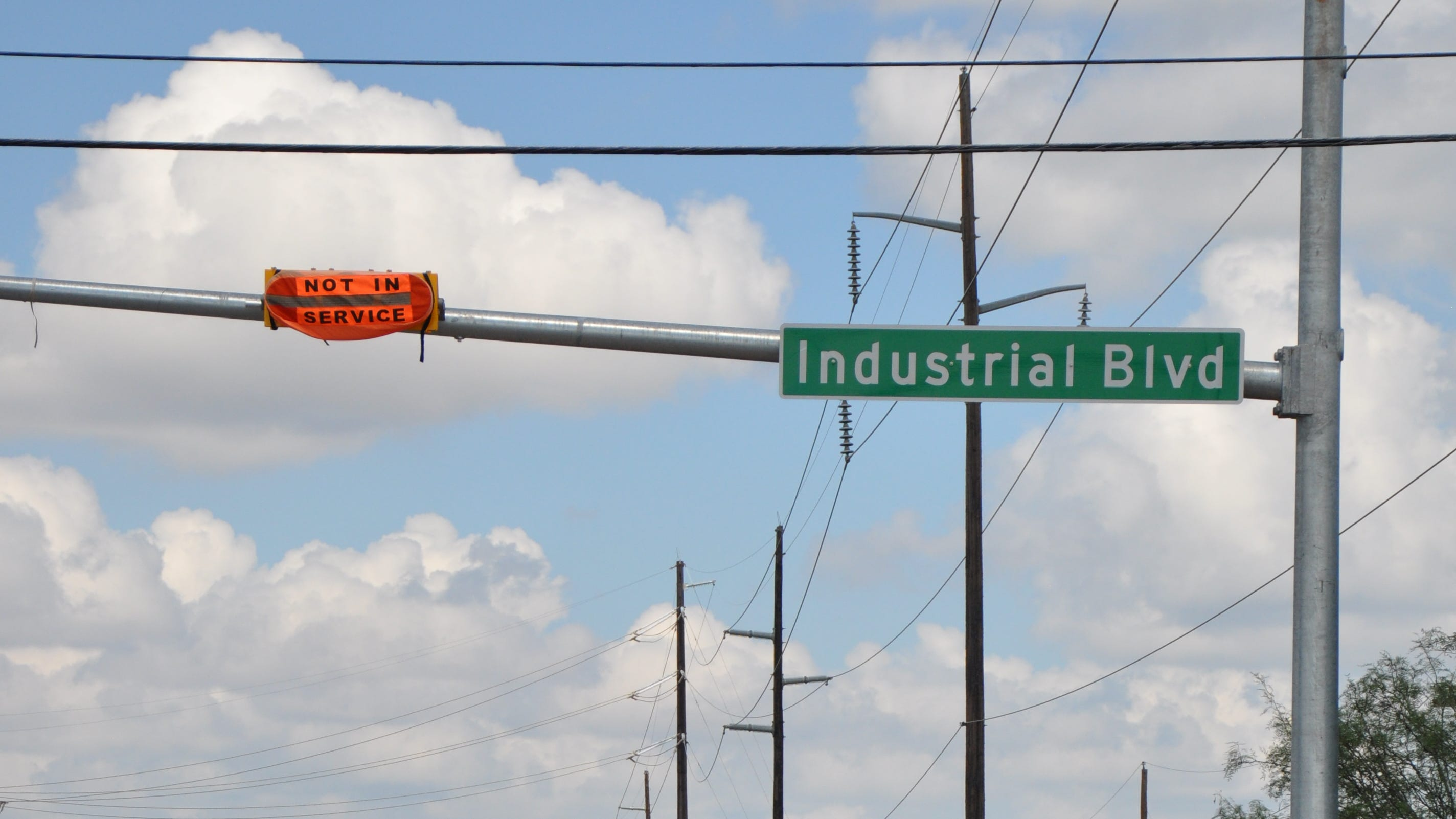 An orange cover is on a new traffic signal at Industrial Boulevard and Maple Street on Monday, Sept. 17, 2018. The new signal with the flashing-yellow system is the first of its kind being installed by the City of Abilene.