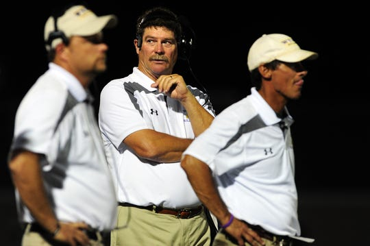 Wylie coach Hugh Sandifer stands between assistant coaches Chris Kincaid, left, and Clay Martin during a 2013 game. Martin joined Sandifer's staff in 1993 while Kincaid was the team's quarterback in 1994 and returned as a coach in 2009. Both Martin and Kincaid, along with some others, could be possible options for the school board to fill Sandifer's position from within.