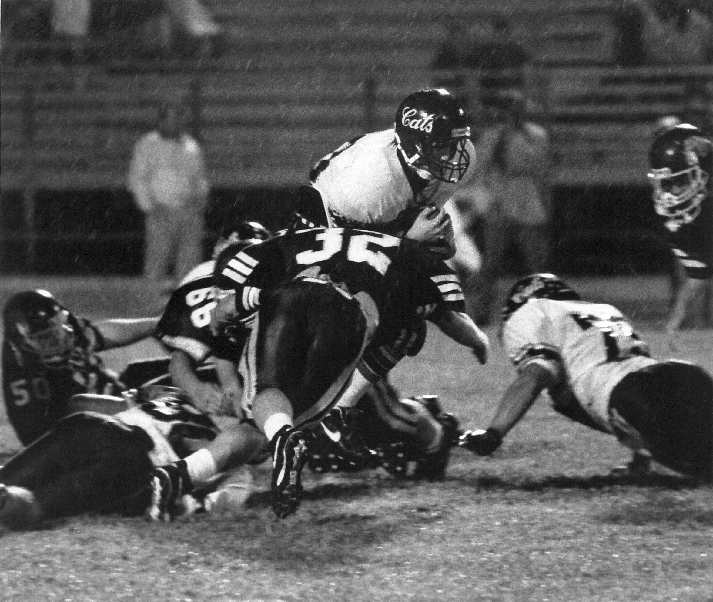 A pair of Wylie defenders converge on a Ballinger running back during a game in 1994.