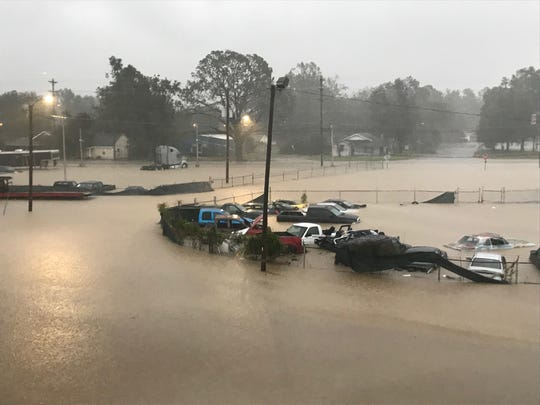 A parking lot in Lumberton, N.C., sits underwater on Sept. 16, 2018.