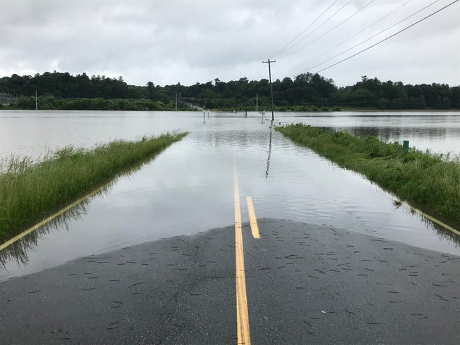Butler Bridge Road in Henderson County, which crosses the French Broad River, is prone to flooding during heavy rains, as was the case this past May. The flood plain is wide in this particular area, allowing the water to spread out more.
