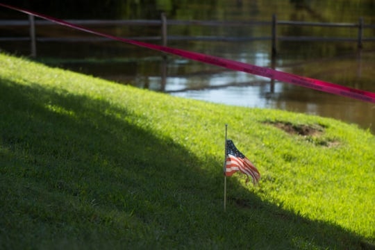 A flag marks where the Cape Fear River rose to during Hurricane Matthew in 2016 at Deep Creek Outfitters in Fayetteville, N.C., Monday, Sept. 17, 2018. The flood stage for the Cape Fear River is 35 feet, and after Florence the river stands at 54.35 feet. It is predicted to peak at 61.8 feet according to the National Weather Service.