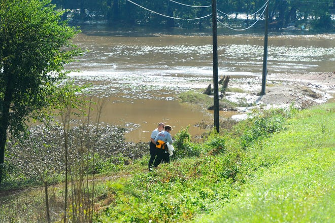 Rescue workers recover the body of a 1-year-old in Union County on Monday after the child was swept away in floodwaters resulting from the remnants of Hurricane Florence on Sunday.