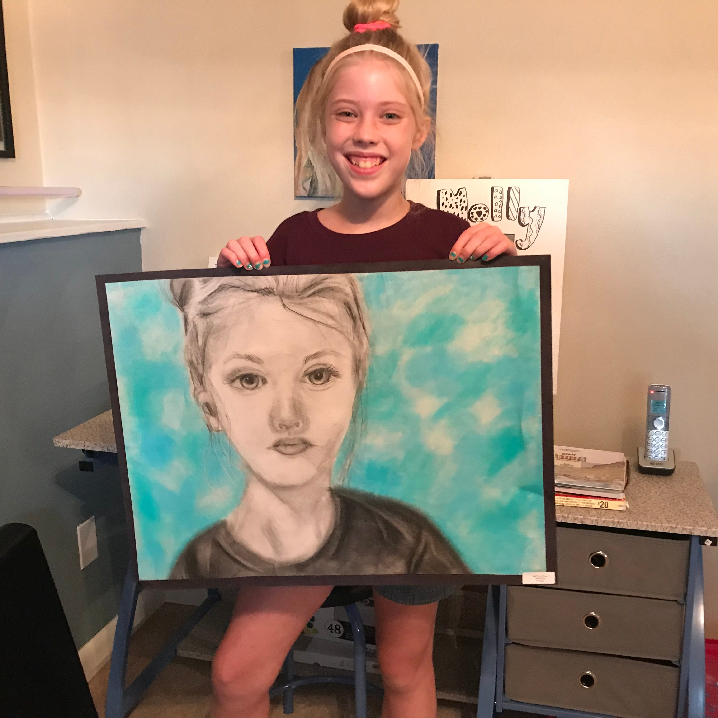 GALLERY: Johnson City seventh grader sees work projected downtown
