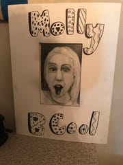 "Johnson City Central School District seventh-grader Molly Jablonowski, 12, has been creating art for the past five years. A self-portrait reads ""Molly B Cool."""