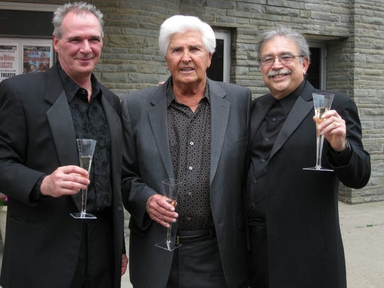 From left, Patrick Foti, Robert Eckert and Lou Liguori celebrate the forgiving of the Endicott Performing Arts Center mortgage in 2010. The theater was named after Eckert in honor of this.