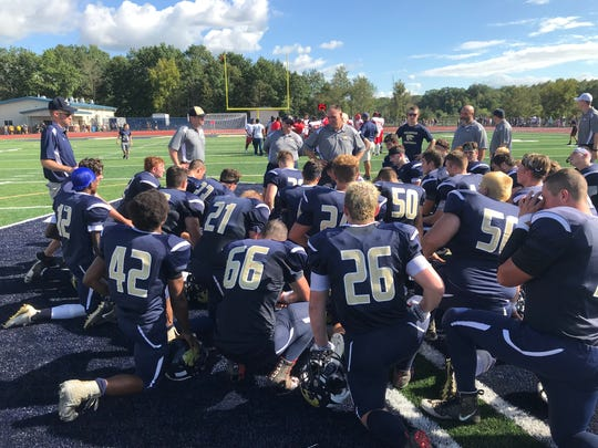 Susquehanna Valley coaches addresss the team following Saturday's 57-0 victory over visiting Syracuse Fowler.