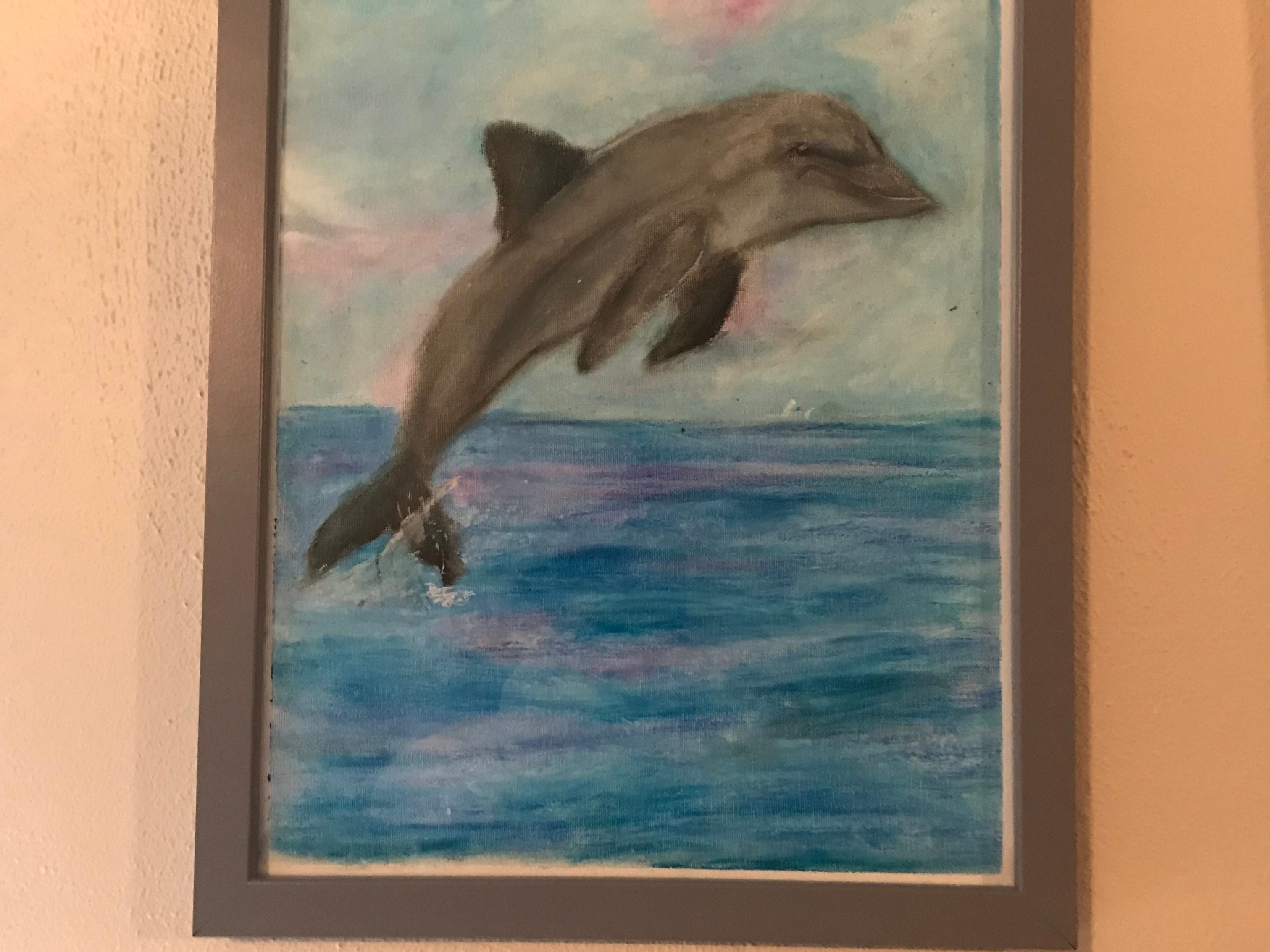 Johnson City Central School District seventh grader Molly Jablonowski, 12, has been creating art for the last 5 years. Among her work is this oil pastel dolphin, which hangs in the living room of her Johnson City home.