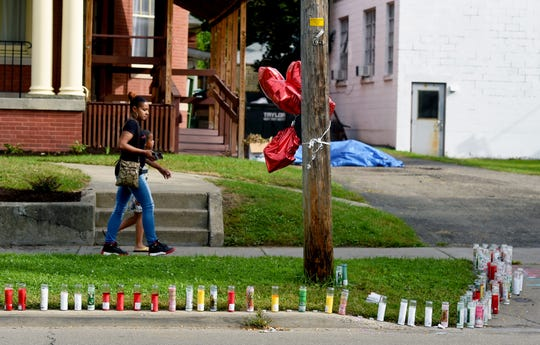 Candles and balloons mark the scene of a fatal drive-by shooting in Binghamton. The shooting happened in the early morning hours of Sunday, September 16, on Main St., between Walnut Street and Chapin Street.  Monday, September 17, 2018.