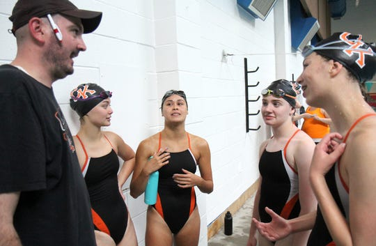 Central Kitsap swim coach Patrick McKenzie talks to swimmers, from left, Chelsea Miller, Taylor Sims, Haley Monkert and Eleanor Hebard during a recent meet.