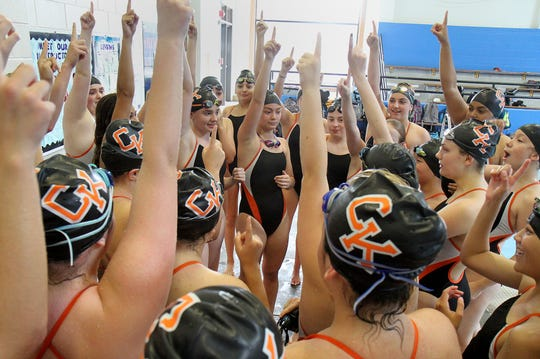 The Central Kitsap girls swim team rallies before the start of a meet against Timberline.