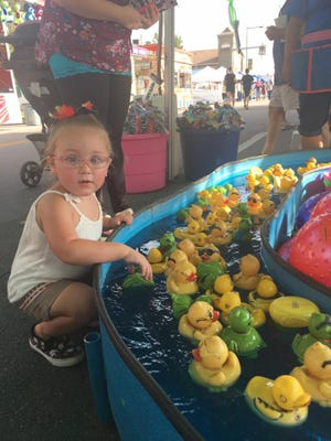 Alaina Davis plays a duck pond game at the 2017 Crestline Harvest Festival.