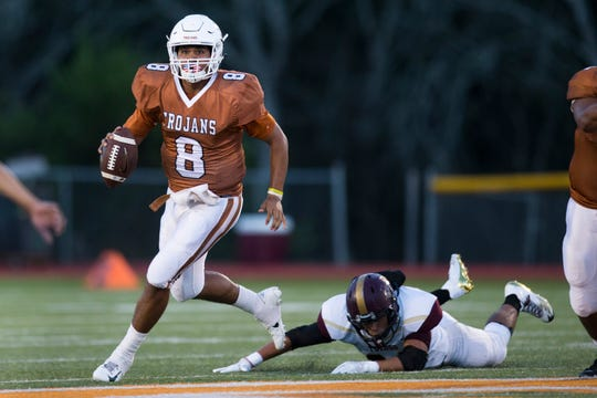 Beeville's Seth Gomez rolls out against Tuloso-Midway during their game on Thursday, Sep. 14, 2018, at Veterans Memorial Stadium in Beeville.