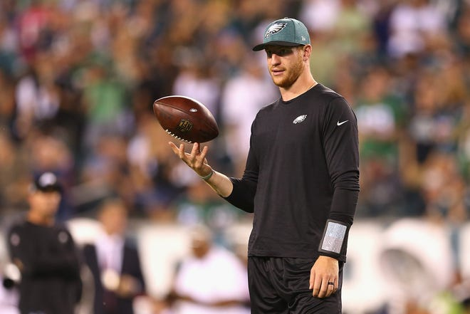 PHILADELPHIA, PA - SEPTEMBER 06:  Carson Wentz #11 of the Philadelphia Eagles looks on before the game against the Atlanta Falcons at Lincoln Financial Field on September 6, 2018 in Philadelphia, Pennsylvania.  (Photo by Mitchell Leff/Getty Images)