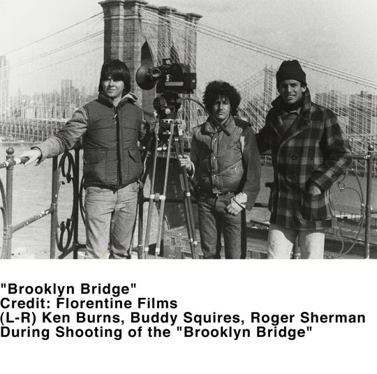 """The Brooklyn Bridge in New York City rises behind director Ken Burns (from left) and two of his film producers,  Buddy Squires and Roger Sherman, during filming of the span for his first documentary, """"Brooklyn Bridge,"""" released in 1981. Burns is unveiling a restored film version on Saturday in Roebling in Burlington County."""