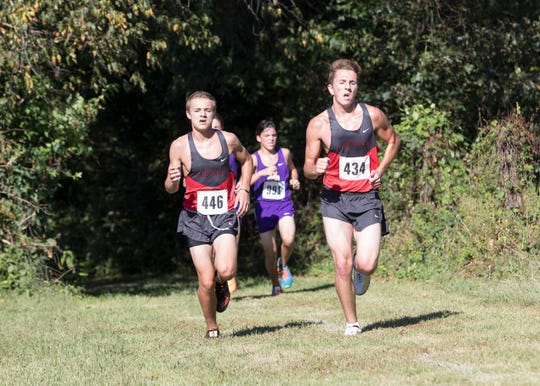 Westfall's Tyler Shipley, left, and Preston Fyffe run alongside one another during the 2018 Aaron Reed Cross Country Invitational. Westfall took third overall with an average time of 19:20.53, behind Unioto and Miami Trace.