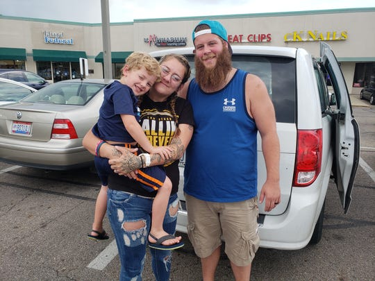 Levi Rittenhouse (right) poses for a photo with his wife, Brittney, and their son, Hunter, the week he was set to complete his program at the Refuge.
