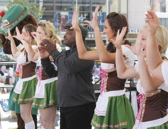 Joe Morgan with some help from the University of Cincinnati Dance Team lead The World's Largest Chicken Dance at Fountain Square Sept. 17, 2011 The Enquirer/ Tony Jones