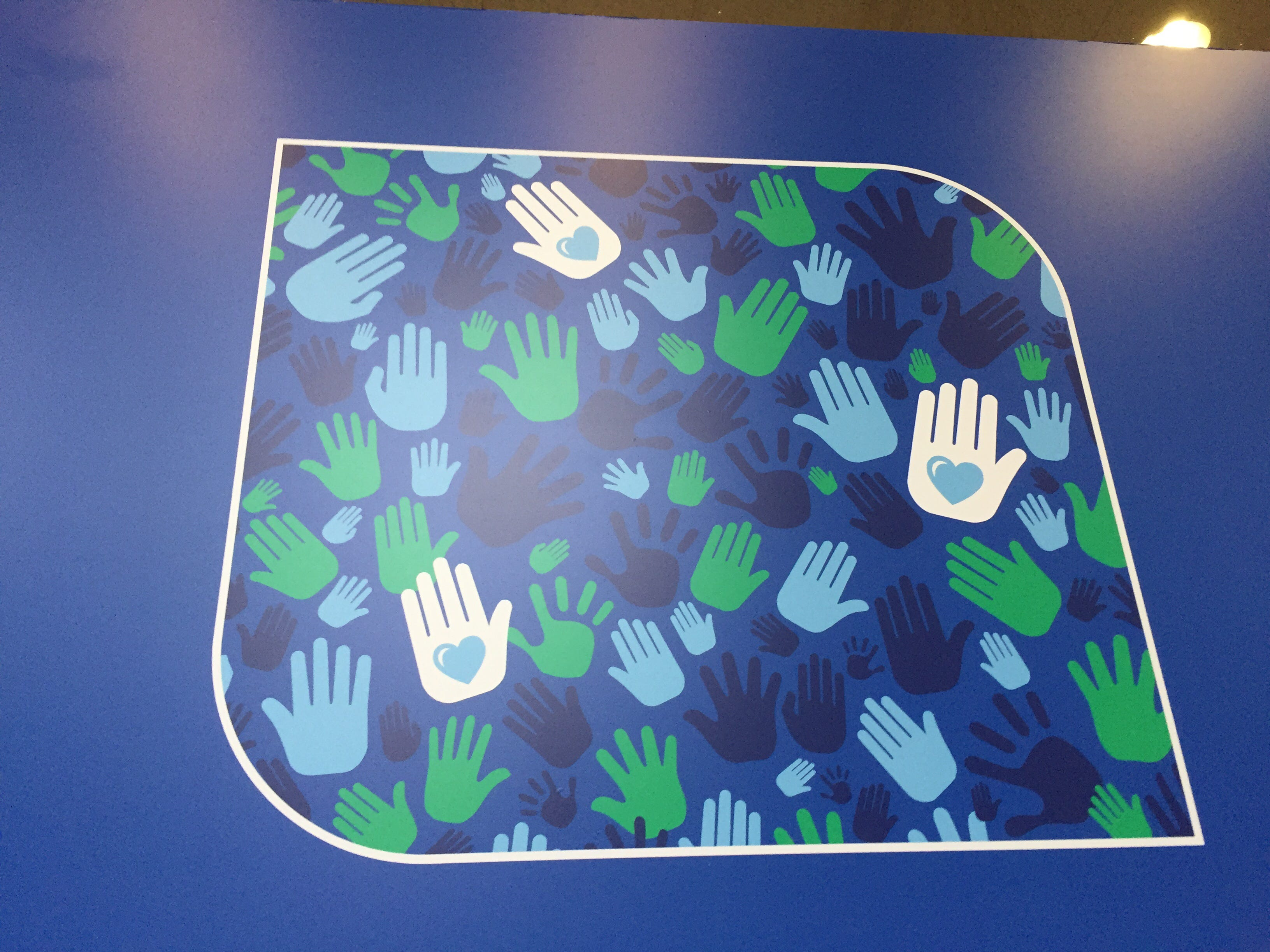 Hand prints are featured heavily at the Fifth Third Center lobby reopening on Monday.