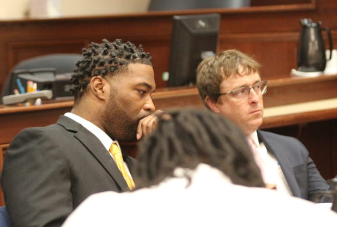 Kellum Williams, left and his attorney, Chase Smith, listen to opening statements Monday, while Kevin Forman looks down.