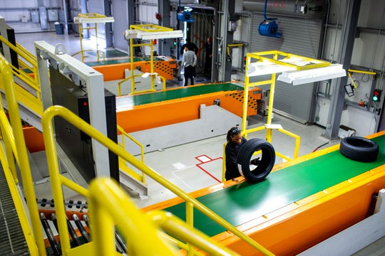 An employee inspects tires before shipment at the Hankook Tire plant Thursday, Sept. 13, 2018, in Clarksville, Tenn.