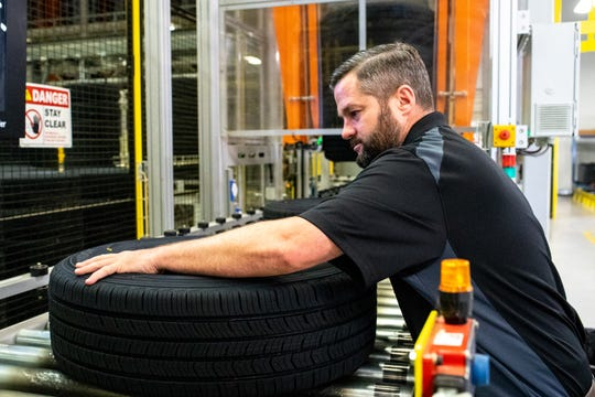 Brian Olds inspects tires before shipment at the Hankook Tire plant Thursday, Sept. 13, 2018, in Clarksville, Tenn.