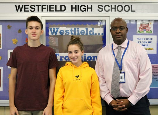 WHS junior Thomas Lupicki and senior Julia Plawker received perfect scores of 800 on the Chemistry portion and Math Level 2 portion respectively of the Aug. 2018 SAT.  Pictured with Principal Dr. Derrick Nelson.