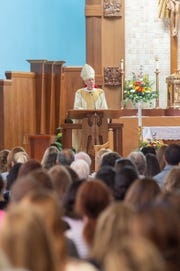 Bishop James F. Checchio presides over Mass for Catholic school teachers, administrators.