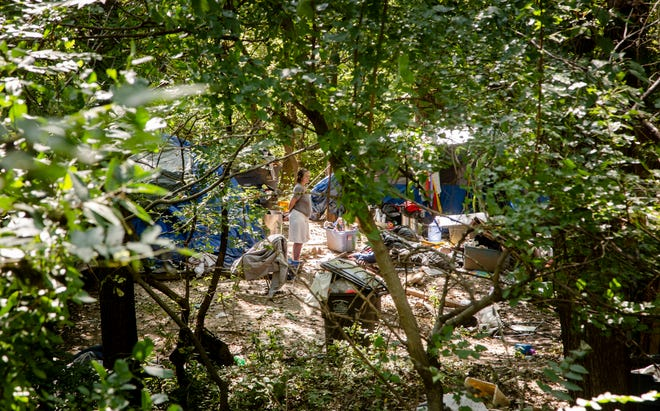 A homeless camp in the woods behind the Des Moines OnStage building at 2124 Grand Ave. Sept. 11, 2018.
