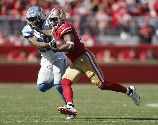 San Francisco 49ers WR Pierre Garcon runs after a catch against Detroit Lions CB Quandre Diggs in the fourth quarter Sunday, Sept. 16, 2018 at Levi's Stadium in Santa Clara, Calif.