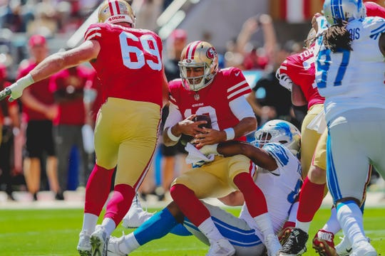 49ers quarterback Jimmy Garoppolo is sacked by Lions linebacker Devon Kennard in the first quarter.