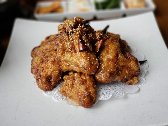 Sweet and spicy fried chicken wings from Jinji, a Korean restaurant and soju bar inside the New Seoul Plaza in Southfield.