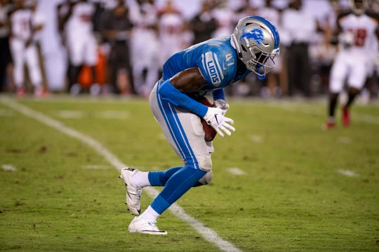 Detroit Lions safety Tracy Walker makes an interception against the Tampa Bay Buccaneers during an exhibition game Aug. 24, 2018.