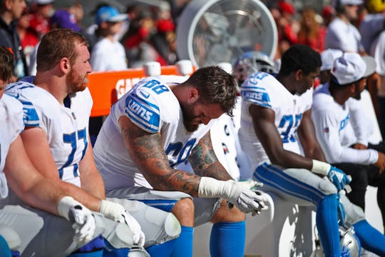 Lions tackle Taylor Decker (68) and center Frank Ragnow (77) sit on the bench during the second half of the loss to the Niners.