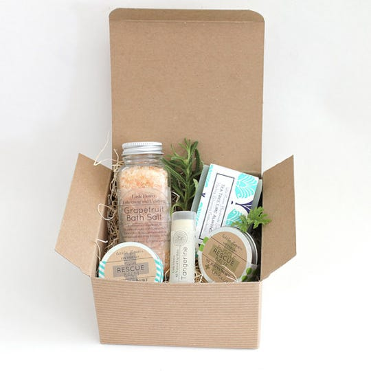 A box of The Little Flower Soap Co. products.